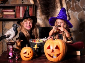 Witch  children with pumpkin lantern. .